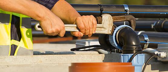 worker adjusting pipe