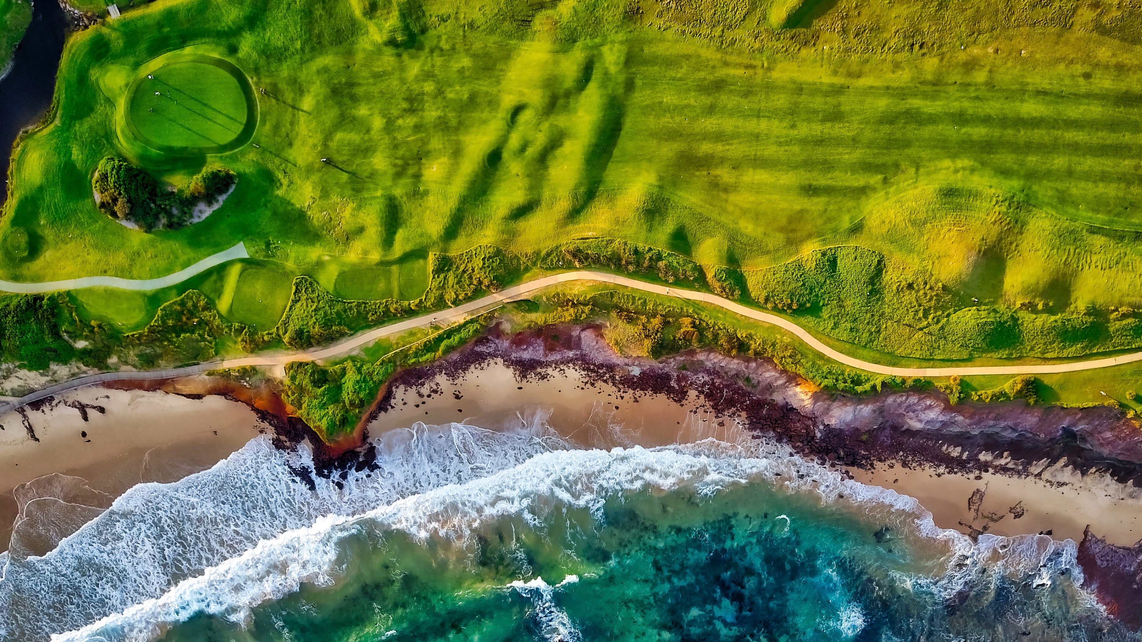 A beachside golf course is shown from an aerial view in this photo found on the Landcrafters' website.